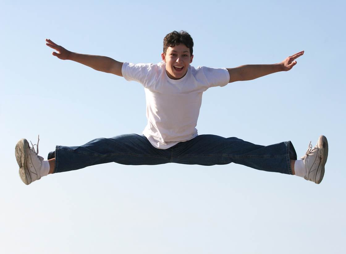 Boy making a split high in the air
